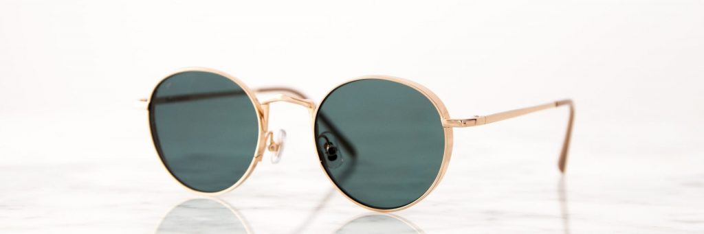 vintage sunglasses with dark lenses and gold frame